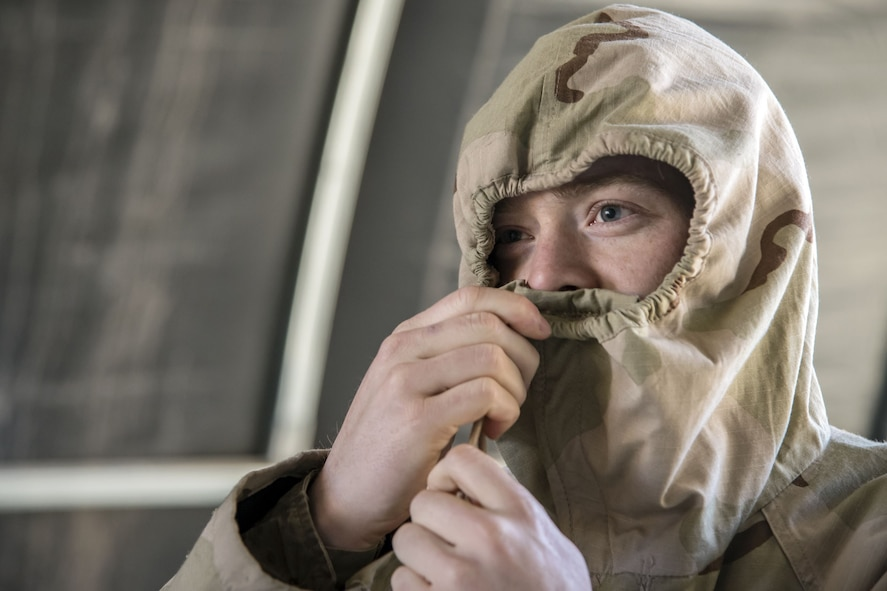 Senior Airman Collin Chase, 23d Maintenance Squadron aircraft fuels systems journeyman, tightens the barrel locks on the hood of his overcoat, Feb. 1, 2018, at Moody Air Force Base, Ga. Airmen participated in a chemical, biological, radiological and nuclear defense (CBRNE) class to better prepare them to combat enemy attacks while also familiarizing them with mission-oriented protective posture (MOPP) gear. (Air Force photo by Airman Eugene Oliver)