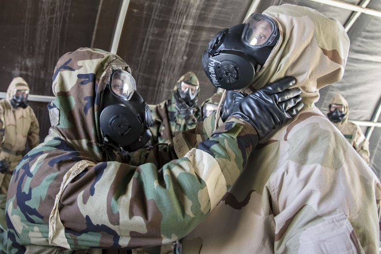 Staff Sgt. Christopher Windley, 23d Force Support Squadron fitness specialist, left, performs a seal check on Staff Sgt. Ryan Cox, 820th Combat Operations Squadron combat arms instructor, Feb. 1, 2018, at Moody Air Force Base, Ga. Airmen participated in a chemical, biological, radiological and nuclear defense (CBRNE) class to better prepare them to combat enemy attacks while also familiarizing them with mission-oriented protective posture (MOPP) gear. (Air Force photo by Airman Eugene Oliver)