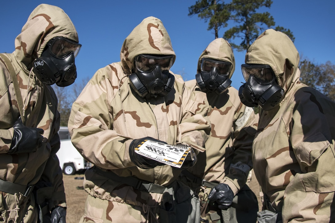 Airmen read an Airman's manual, Feb. 5, 2018, at Moody Air Force Base, Ga. Airmen participated in a chemical, biological, radiological and nuclear defense (CBRNE) class to better prepare them to combat enemy attacks while also familiarizing them with mission-oriented protective posture (MOPP) gear. (Air Force photo by Airman Eugene Oliver)