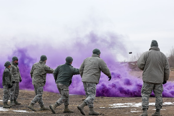 114th Security Forces Squadron members deploy smoke grenades during Explosive Ordinance Disposal (EOD) training at a range a few miles west of Sioux Falls, Feb. 3, 2018.