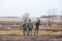 114th Security Forces Squadron members deploy ground burst simulators during training at a range near Joe Foss Field, S.D. Feb. 3, 2018.
