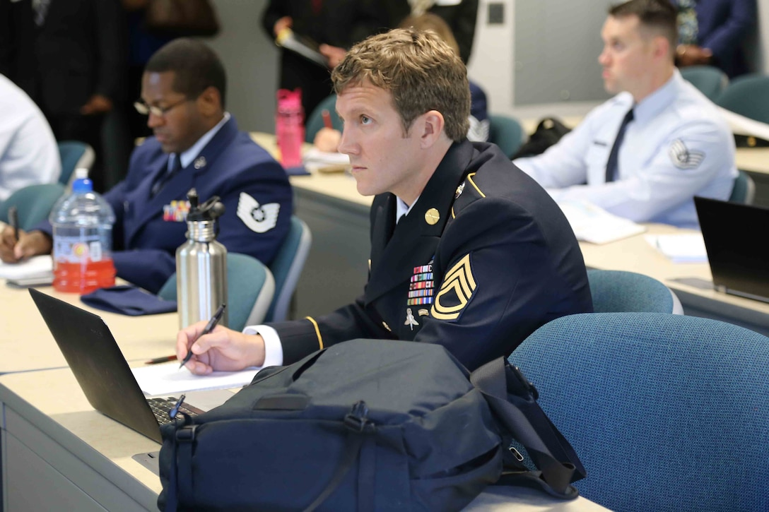 Army Sgt. 1st Class Joshua Richter listens to a lecture at George Mason University-Prince William Campus as a student in the Uniformed Services University of the Health Sciences' Enlisted to Medical Degree Preparatory Program in 2014.