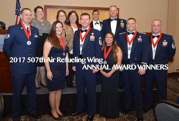The 2017 507th Air Refueling Wing Annual Award winners pose for a photo Feb. 3, 2018, in Midwest City, Okla. Front row: Staff Sgt. Casey Cottrell, NCO of the Year; Mrs. Lauren Gleason, Civilian of the Year; Senior Master Sgt. Ronald Pyles, 1st Sgt. of the Year; Mrs. Jennifer Smith, Spouse of the Year; 2nd Lt. Ryan Cheney, Company Grade Officer of the Year; and Master Sgt. Ricky Buettner, Senior NCO of the Year. Back row: Community partners Mrs. Tasha Windisch, Ms. Kathy Gillette and Ms. Jan Davis from the Moore Chamber of Commerce and Tinker Federal Credit Union; Col. Dana Nelson, 507th Air Refueling Wing vice commander; ahd Chief Master Sgt. David Dickson, 507th ARW command chief. (U.S. Air Force photo/Tech. Sgt. Samantha Mathison)