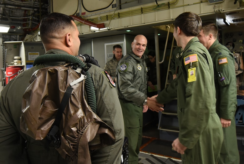Gen. Carlton D. Everhart II, Air Mobility Command commander, meets 1st Lt. John Dewilder, 4th Airlift Squadron pilot, while greeting the C-17 Globemaster III crew of a C-17 Globemaster III he would be flying with at Joint Base Lewis-McChord, Wash., Jan. 25, 2018. Everhart visited JBLM to witness full-spectrum readiness in action during Team McChord's Exercise Winterhook. (U.S. Air Force photo by Senior Airman Tryphena Mayhugh)