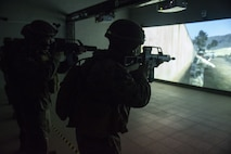 U.S. Marines with Special Purpose Marine Air-Ground Task Force-Crisis Response-Africa train with G36 service rifles in a virtual simulator at the San Fernando Barracks, Spain, Jan. 9, 2017. SPMAGTF-CR-AF is deployed to conduct limited crisis-response and theater-security operations in Europe and North Africa. (U.S. Marine Corps photo by Sgt. Takoune H. Norasingh/Released)