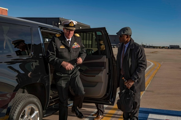 AFOSI SA Donavan Muir (right) assists Vice Adm. Ray Griggs, Vice Chief of the Australian Defence Force, at Peterson AFB, Colo., Dec. 3, 2017. SA Muir was part of a PSO mission providing security for Griggs. (U.S. Air Force photo by Dave Grim)