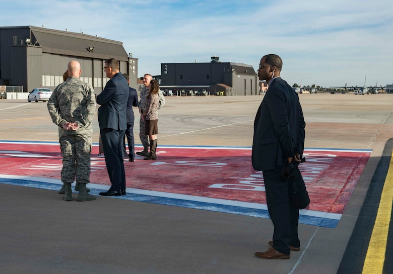 AFOSI SA Donavan Muir stands at the ready at Peterson AFB, Colo., Dec. 3, 2017, as Gen. Lori Robinson, commander of U.S. Northern Command and North American Aerospace Defense Command, Gen. Jay Raymond, AFSC and Joint Force Space Component commander and Col. Eric Dorminey, vice commander of the 21SW, speak with Vice Adm. Ray Griggs, Vice Chief of the Australian Defence Force. SA Muir was part of a Protective Services Operations mission providing security for Griggs. (U.S. Air Force photo by Dave Grim)