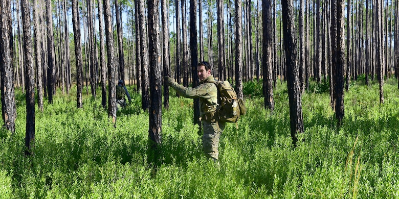 Staff Sgt. Jonathan Buchanan, 325th Operations Support Squadron NCO in-charge of SERE operations and training, surveys a potential training area around Tyndall Air Force Base for Tyndall's SERE program, Jan. 17, 2018. The SERE specialists at Tyndall have the special duty of ensuring that all qualifying personnel keep their training up-to-date and refreshed. (U.S. Air Force photo by Senior Airman Cody R. Miller/Released)