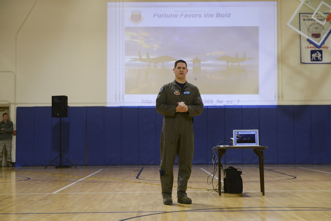 Col. Joe Kunkel, 366th Fighter Wing commander, answers an Airman's question during a commander's call Jan. 26, 2018, at Mountain Home Air Force Base, Idaho. Kunkel outlined the wing's priorities and how he plans to ensure the wing has a successful year.