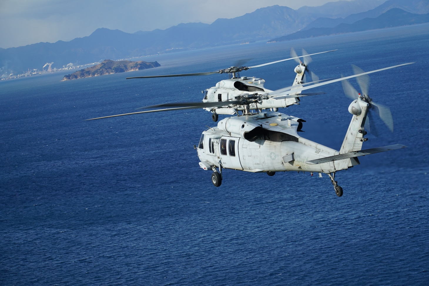 U.S. Navy MH-60R and MH-60S Seahawk helicopters, assigned to Helicopter Maritime Strike Squadron (HSM) 51 and Helicopter Sea Combat Squadron (HSC) 25 rendezvous off the coast of Hiroshima