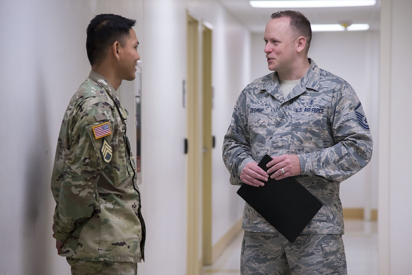 Master Sgt. Robert George, Medical Education & Training Campus pharmacy training senior enlisted leader, speaks with a pharmacy student at Joint Base San Antonio-Fort Sam Houston, Feb. 5, 2018. George leads Department of Defense's pharmacy technician program prepares students to perform both inpatient and outpatient pharmacy operations in both traditional and non-traditional pharmacy practice. (U.S. Air Force photo by Sean M. Worrell)