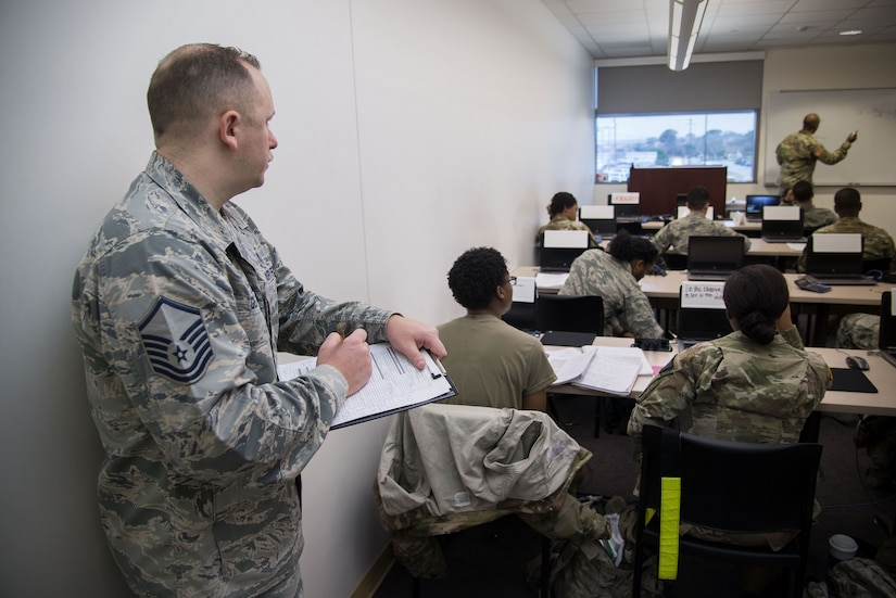 Master Sgt. Robert George, Medical Education & Training Campus pharmacy training senior enlisted leader, writes an evaluation on an instructor in training at Joint Base San Antonio-Fort Sam Houston, Feb. 5, 2018. The Department of Defense's pharmacy technician program prepares students to perform both inpatient and outpatient pharmacy operations in both traditional and non-traditional pharmacy practices. (U.S. Air Force photo by Sean M. Worrell)