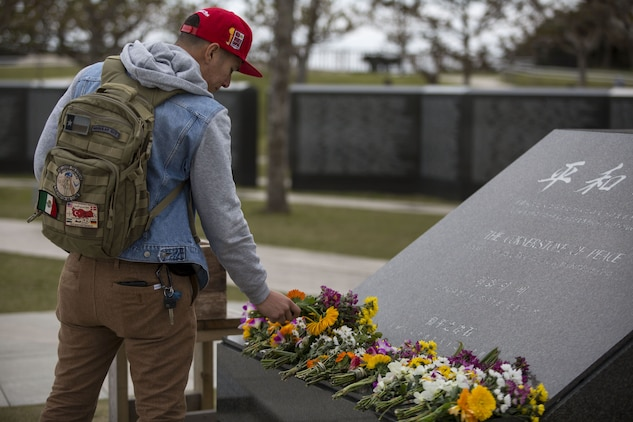 Senior Airman Briant Rodriguez pays his respects at the Cornerstone of Peace