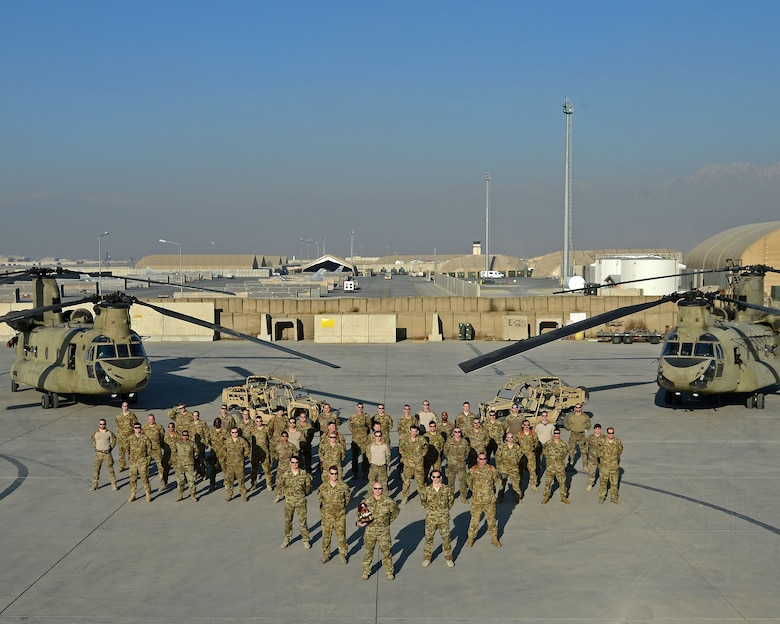 The 83rd Expeditionary Rescue Squadron poses for a photo at Bagram Airfield, Afghanistan. The 83rd ERQS is Air Force Central Command's first dedicated joint personnel recovery team, utilizing Air Force Guardian Angel teams and Army CH-47 Chinook crews. (U.S. Air Force photo by Staff Sgt. Divine Cox)