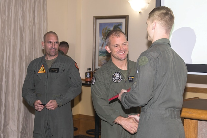 Aviators and air traffic controllers graduate the Marine Division Tactics Course graduation aboard Marine Corps Air Station Beaufort, Feb. 2.