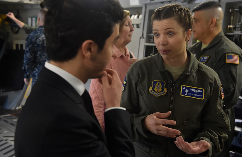 U.S. Air Force Staff Sgt. Nichole Bryant, 315th Aeromedical Evacuation Squadron, talks to a North Atlantic Treaty Organization Parliamentary Assembly Defense and Security Committee member during a tour of a C-17 Globemaster III as part of a Congressional Delegation and NATO Partners event Feb. 8, at Joint Base Charleston, S.C. The visit provided NATO PA members an opportunity to speak with JB Charleston leadership, tour a C-17 Globemaster III, receive a briefing focused on aeromedical evacuation and learn about the Transportation Isolation System's capabilities.