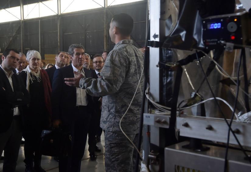 North Atlantic Treaty Organization Parliamentary Assembly Defense and Security Committee members are briefed by U.S. Air Force Maj. Scott King, 628th Aerospace Medicine Squadron bioenvironmental engineer flight commander, on the capabilities of a Transport Isolation System during a tour as part of a Congressional Delegation and NATO Partners event Feb. 8, at Joint Base Charleston, S.C. The visit provided NATO members an opportunity to speak with JB Charleston leadership, tour a C-17 Globemaster III, receive a briefing focused on aeromedical evacuation and learn about the Transportation Isolation System's capabilities.