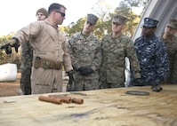 An Explosive Ordnance Disposal Marine gives a lesson to Marines and Sailors during a Demo Day, aboard Marine Corps Air Station Beaufort, Feb. 1. EOD hosted the Demo Day so other Marines and Sailors could see how they conduct operations.