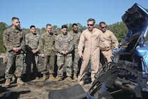 An Explosive Ordnance Disposal Marine shows Marines and Sailors the remains of a car after a detonation, aboard Marine Corps Air Station Beaufort, Feb. 1. EOD hosted the Demo Day so other Marines and Sailors could see how they conduct operations.