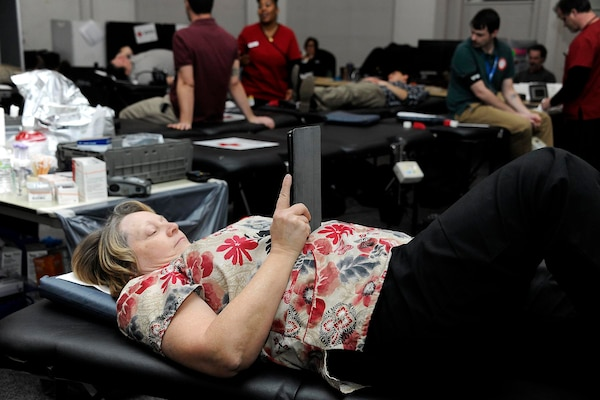 Occupational Health Nurse Sharon Butters, a Defense Logistics Agency employee, donates a pint herself at the Feb. 7 blood drive she helped to coordinate.