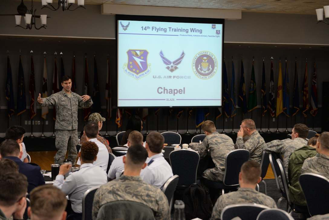 Chaplain (Maj.) Bradley Kimble, 14th Flying Training Wing Deputy Wing Chaplain, speaks at a Wing Newcomers Orientation brief Feb. 18, 2017, on Columbus Air Force Base, Mississippi. The newcomers brief is a way to get familiar with all the different organizations on base and learn how Columbus AFB operates. (U.S. Air Force photo by Airman 1st Class Keith Holcomb)