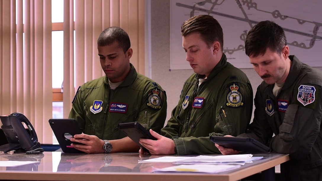 Pilots from the 351st Air Refueling Squadron receive weather briefs on their tablets prior to take-off at RAF Mildenhall, England, Feb. 1, 2018. The weather briefs contain information which helps with mission planning and execution. (U.S. Air Force photo by Senior Airman Kelly O'Connor)