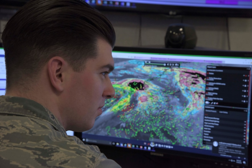 U.S. Air Force Senior Airman Austin Denney, 100th Operation Support Squadron weather journeyman, plans for an upcoming weather brief at RAF Mildenhall, England, Feb. 1, 2018. The weather briefs contain information about what the weather is going to be like during the air refueling mission. (U.S. Air Force photo by Senior Airman Kelly O'Connor)