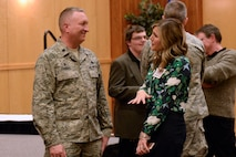 Lt. Col. Will Thomas, 649th Munitions Squadron Commander, welcomes his Honorary Commander, Amber Greenwell, Select Employer Group Manager for America First Credit Union, during the Team Hill Honorary Commander Induction and Alumni Reception Feb. 1. Thirty community leaders were inducted into the program through a formal recognition ceremony held on base. The program is designed to increase public awareness and understanding of Air Force missions and capabilities through key relationships. (U.S. Air Force photo by Todd Cromar)