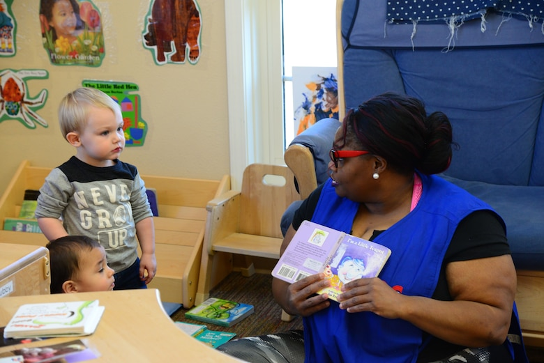 Natasha Sykes, 14th Force Support Squadron Child Development Center direct care staff, reads to children Feb. 5, 2018, on Columbus Air Force Base, Mississippi. Staff at the Columbus CDC take time to ensure that the children are engaged and interactive with the curriculum taught. (U.S. Air Force photo by Airman 1st Class Beaux Hebert)