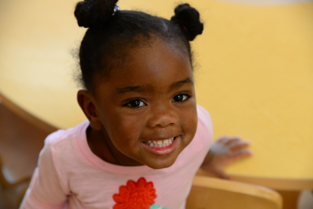 Ava, daughter of Tech. Sgt. Mia Johnson, 14th Force Support Squadron Logistics Manager, enjoys her time at the Child Development Center Feb. 5, 2018, on Columbus Air Force Base, Mississippi. Children are taught basic social skills that will help them as they get older. (U.S. Air Force photo by Airman 1st Class Beaux Hebert)