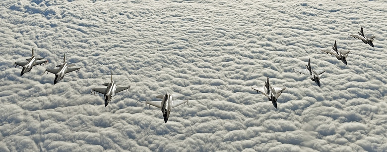 Four U.S. Air Force F-16C Fighting Falcons and four Swedish Air Force JAS 39 Gripens fly in formation during aerial refueling training in Swedish airspace, Feb. 8, 2018. The air refueling training is in conjunction with a rotational deployment of F-16Cs from the Ohio Air National Guard's 180th Fighter Wing to Amari Air Base, Estonia, as part of a Theater Security Package. The training allows the U.S. and Sweden to strengthen interoperability and increase readiness.  (U.S. Air Force photo by Airman 1st Class Luke Milano)