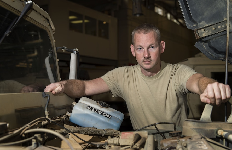 U.S. Air Force Tech. Sgt Robert Black, NCO in charge of main shop assigned to the 97th Logistics Readiness Squadron, poses for a portrait at the 97th LRS vehicle maintenance shop, Feb. 9, 2018, at Altus Air Force Base, Okla.