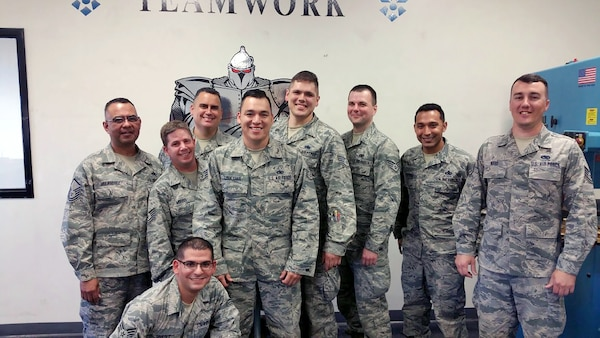 Staff Sgt. Nathan Ward (far right) poses for a group photo with his fellow 149th Fighter Wing members during a regularly scheduled drill weekend at his shop, headquartered at Joint Base San Antonio-Lackland, Texas.