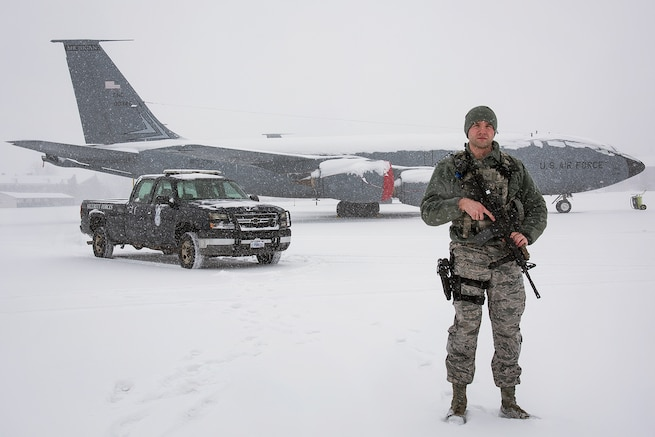 Senior Airman Robert Wodowski, defender with the 127th Security Forces Squadron here, secures a KC-135 Stratotanker on the flight line today, This weekend, Woodowski and other personnel of the 127th Wing will continue to endure harsh weather conditions as a significant winter storm commences upon the metropolitan Detroit region. Local weather reports estimate snowfall to accumulate up-to one-foot and sub-freezing temperatures for the next few days. Selfridge Air National Guard Base personnel remain ready for any prescribed contingency and a blizzard during Michigan's winter season provides an opportunity to practice resiliency and readiness while dealing with a well-known, yet hard-to-predict adversary: Mother Nature.