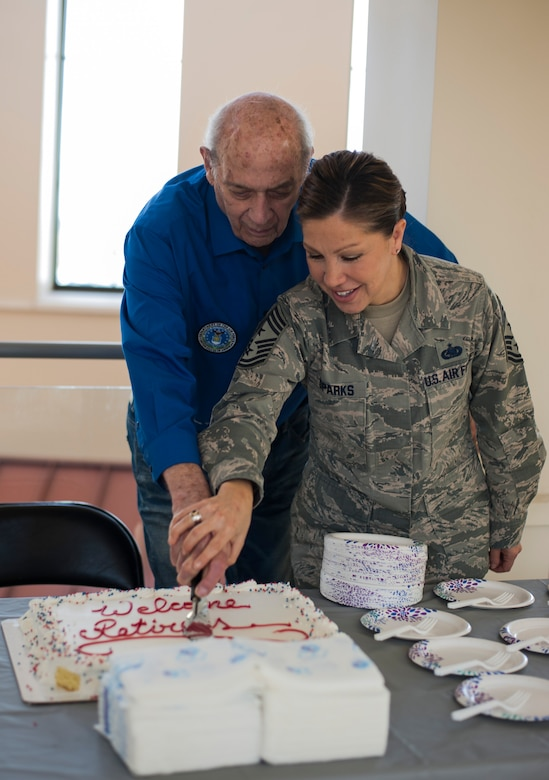 Retired U.S. Air Force Col. William Graham, the director of the MacDill Retiree Activities Office, and Chief Master Sgt. Sarah Sparks, the command chief with the 6th Air Mobility Wing, cut a celebratory cake during Retiree Appreciation Day, Feb. 8, 2018 at MacDill Air Force Base, Fla.