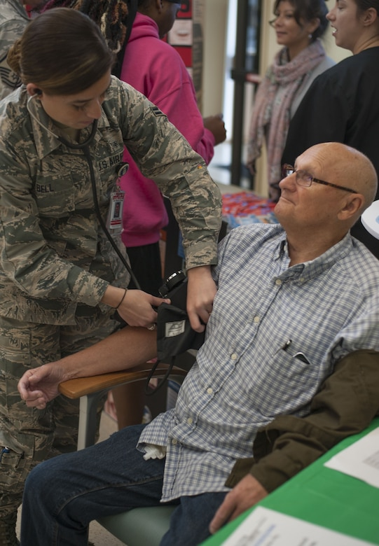Arnold Lueth, a retired U.S. Army staff sergeant, receives a blood pressure screening from U.S. Air Force Airman 1st Class Allexus Bell, an aerospace medical technician assigned to the 6th Medical Operations Squadron, during Retiree Appreciation Day at MacDill Air Force Base, Fla., Feb. 8, 2018.