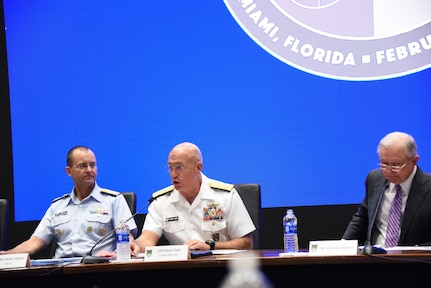 Panelists open a summit on opioids at U.S. Southern Command headquarters.