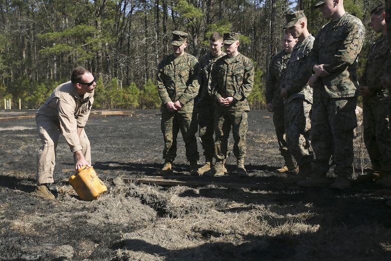 Staff Sgt. Matthew Eades shows Marines and Sailors the remains of materials after a detonation, aboard Marine Corps Air Station Beaufort, Feb. 1. Staff Sergeant Eades is an EOD Technician with Marine Wing Support Detachment 31.