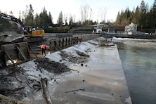 Workers repair the White River Diversion Dam near Buckley, Washington.