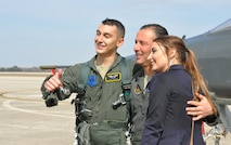 Joe, Chris and Brianna Mirarchi share a photo opportunity following the fini flight. (U.S. Air Force photo by Debbie Gildea)