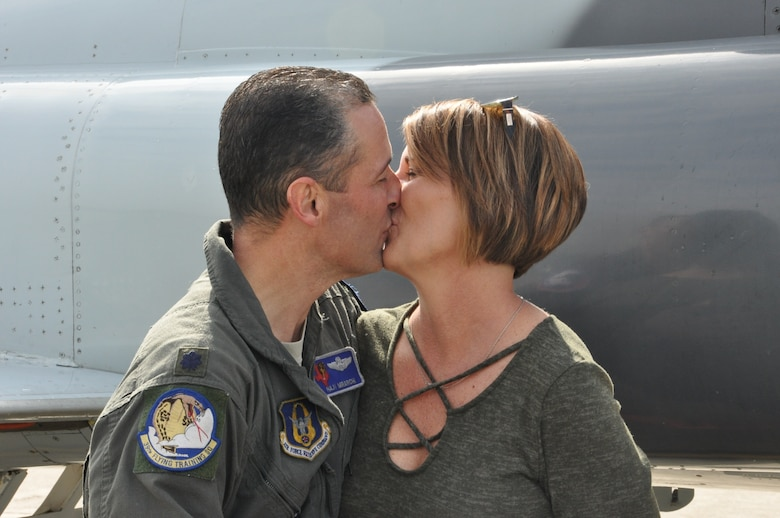 Colonel Mirarchi greets his wife, Teresa, following his successful fini flight. (U.S. Air Force photo by Debbie Gildea)
