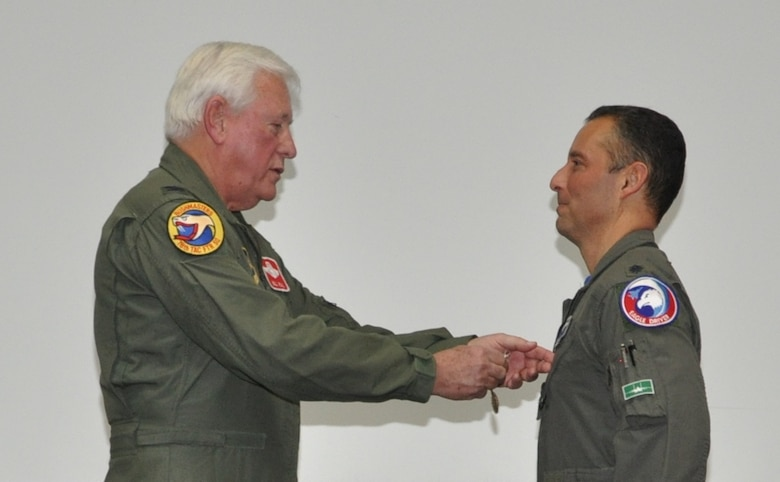 Colonel William Rial (USAF, retired) pins the USAF Meritorious Service Medal on Colonel Mirarchi during the formal retirement ceremony. (U.S. Air Force photo by Debbie Gildea)