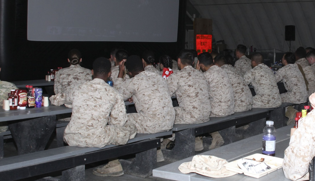 Marines and sailors watch Super Bowl LII on a large screen television in the Camp Wilson mess hall aboard the Marine Corps Air Ground Combat Center, Twentynine Palms, Calif., Feb. 4, 2018. The United Services Organization hosted the event to provide Marines and sailors a way to enjoy the game while in the field. (U.S. Marine Corps photo by Cpl. Natalia Cuevas)