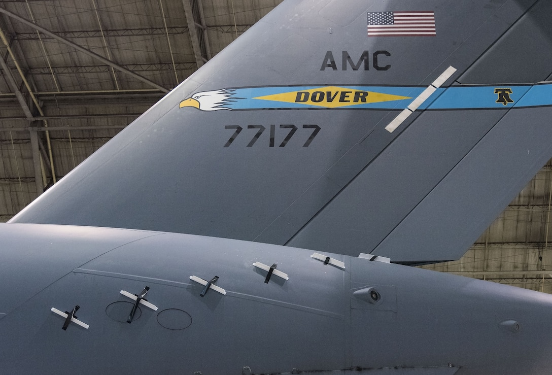 736th Aircraft Maintenance Squadron personnel installed 12 Microvanes, six on each side at the rear of a C-17 Globemaster III fuselage, Sept. 6, 2017, at Dover Air Force Base, Del. The 3D printed glass bead filled nylon Microvanes are 2.4 inches tall and 16 inches in length. This is an effort to reduce drag and fuel consumption. (U.S. Air Force photo by Roland Balik)