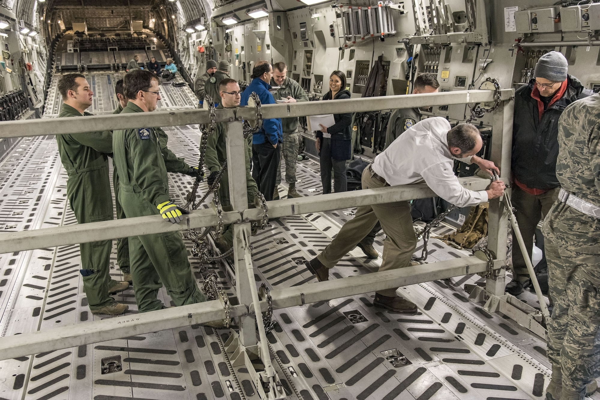 Justin Smoak, Samson Rope application engineering manager, Ferndale, Wash., places a synthetic chain into the slotted interface on the C-17 Globemaster III buffer stop assembly, Jan. 30, 2018 at Dover Air Force Base, Del. The buffer stop assembly is a device used during specific C-17 Globemaster III airdrop missions to keep pallets from shifting forward in the cargo compartment. (U.S. Air Force photo by Roland Balik)