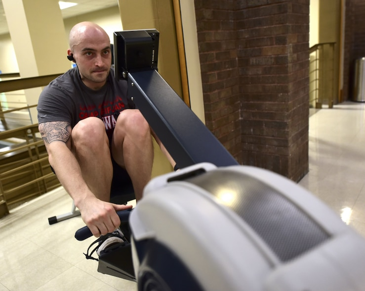 U.S. Air Force Capt. Scott Engman, a Base vs. Base Rowing Challenge participant from the 509th Logistics Readiness Squadron, uses one of designated rowing machines for the competition hosted by the Fitness Center at Whiteman Air Force Base, Mo., Feb. 1, 2018. Each meter rowed will contribute to the overall base average to compete against five other Air Force Global Strike Command bases to win the first Base vs. Base Rowing Challenge Traveling Trophy.