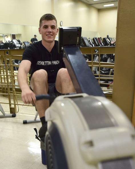 U.S. Air Force Senior Airman Jared Gerlach, the 2017 male rowing challenge winner from the 509th Aircraft Maintenance Squadron, uses an air rower during the Base vs. Base Rowing Challenge opening ceremony at Whiteman Air Force Base, Mo., Feb. 1, 2018. Although the 2018 competition is against other bases within the Air Force Global Strike Command, squadron and individual trophies will still be awarded.