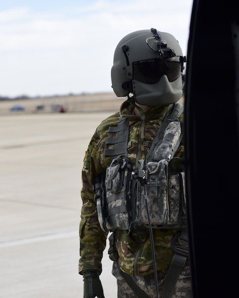 A U.S. Army crew chief with the 1-135th Assault Helicopter Battalion monitors a UH-60 Black Hawk before take off during a joint training at Whiteman Air Force Base, Mo., Jan. 31, 2018. In addition to establishing a partnership, the purpose of the training was to familiarize Joint Terminal Attack Controllers from the 7th Air Support Operations Squadron located in Fort Bliss, Texas, with the assets available at Whiteman AFB that are used in a multi-domain fight.