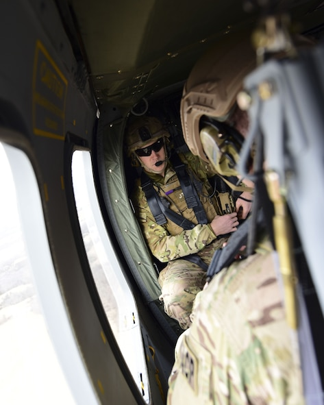 A Joint Terminal Attack Controller rides in a UH-0 Black Hawk during a joint training at Warshaw, Mo., Jan. 31, 2018. This training allowed JTAC to work with to work together units from Whiteman Air Force Base, Mo., to help standardize how JTACs are integrated into a multi-domain fight. (U.S. Air Force by Staff Sgt. Danielle Quilla)