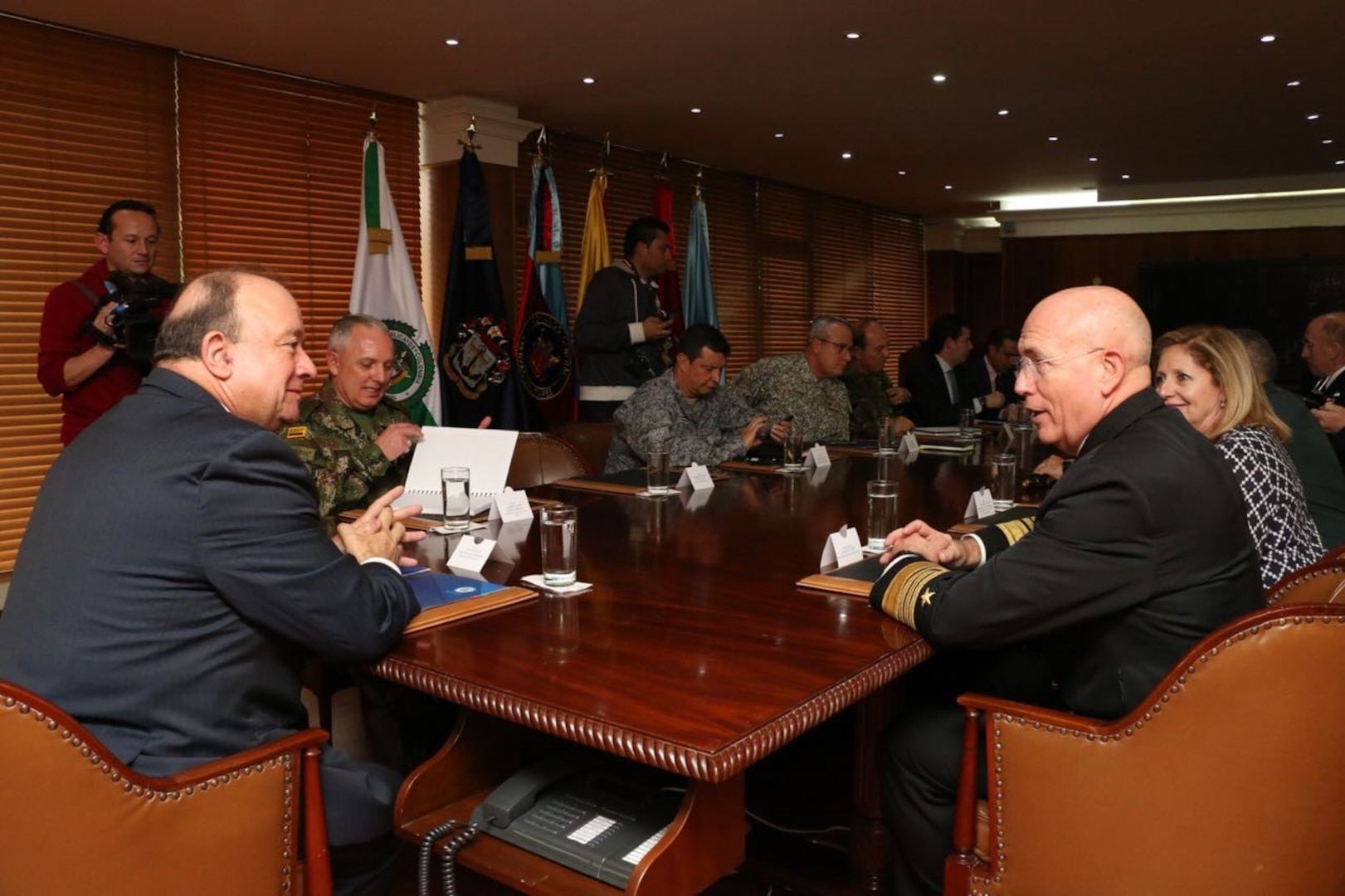 Security leaders speak at a conference table.